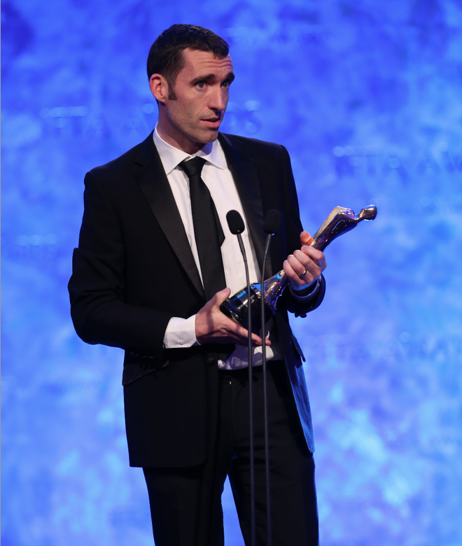 Darach accepting an IFTA award, 2015